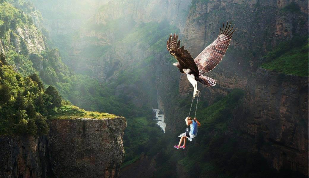 Autoconocimiento-aguila-llevando-a-niño-por-naturaleza-paraiso
